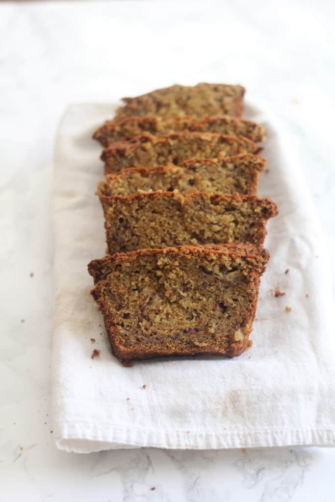 This is seriously the BEST Banana Bread Recipe ever! It comes together easily, has the perfect texture, and is super adaptable! It's everyone's fave and it's no wonder why! #bananabread #baking